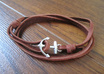 make you a handmade nautical bracelet with a silver anchor and leather strap