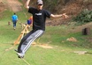 walk across a slackline and do tricks while saying your message to the camera small1