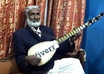 display Your Brand On a Tambura Desi Guitar In a Live Melodious Music Playing Session small1