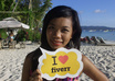 print and hold a sign with your logo or text on Boracay White Beach