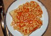 write the message of your choice in alphabetti spaghetti on toast,  photograph it and email you the jpg image for you to use as you wish
