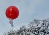 write a message on a tag on a latex helium filled balloon and release it, with photographic evidence which I will send to you